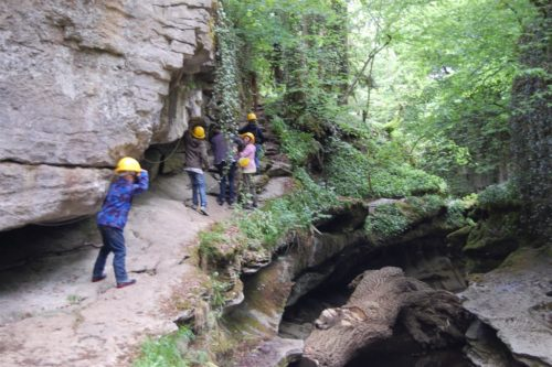 nature's playground at How Stean Gorge, Yorkshire - Children exploring trails by the waters edge -
