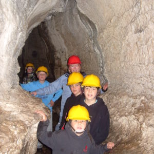 Family exploring the caves at How Stean Gorge, Yorkshire Dales